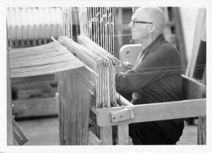 Jim Ahrens threading a loom